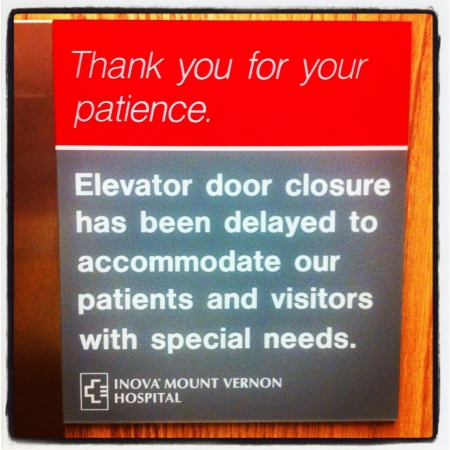 "Elevator sign that reads ""Thank you for your patience. Elevator door closure has been delayed to accommodate our patients and visitors with special needs."""
